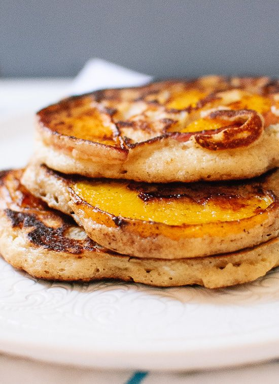 Thinly sliced peaches caramelize as they cook in these delicious, gluten-free, oat and yogurt pancakes. They're peach upside-down pancakes!