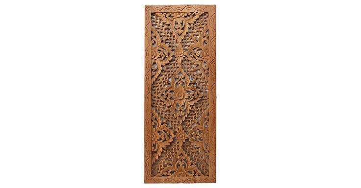The lotus flower is a symbol of purity in Buddhism and of beauty in Hinduism. Here it is at the center of a wonderfully ornate teak panel carved by artisans using techniques passed down for...
