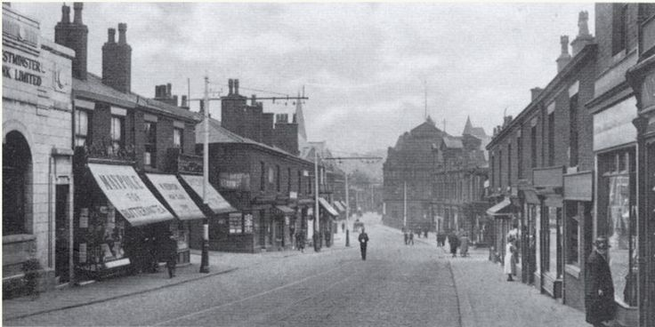Blackburn Street in the early 1920s A policeman stands in the middle of Blackburn Street. The Westminster Bank, Maypole's provisions store and Kenyon's tripe shop - far better remembered as the UCP - are amongst the businesses on the left, while on the extreme right is Marks and Spenser's Penny Bazaar. It was the presence of M and S and Woolworth's that helped give Blackburn Street its 'High Street' feel, even though Stand Lane had the biggest store in town in the Co-operative Emporium.