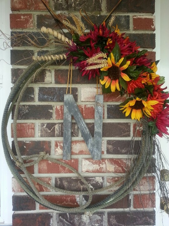 "Western Rope Wreath did this year.  Used one of their ropes and picked up some various greenery and then insert the finishing touch ""N"" for the Circkle N Brand and its a Fall Welcome at our ""Circle N"" Homestead."