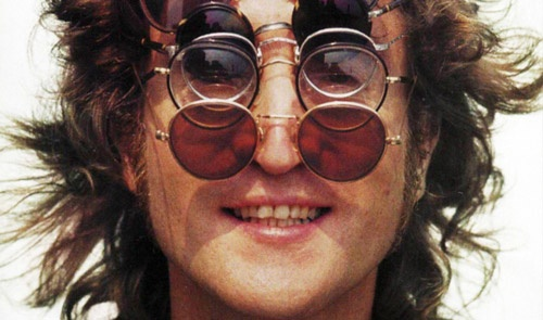 John Lennon styled glasses.
