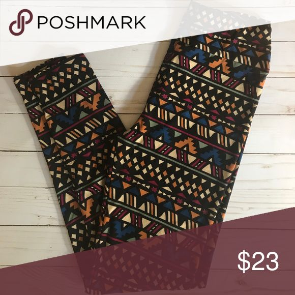 Lularoe • Tribal print leggings Black, blue, green, magenta and orange print. These would look so cute with a long gray cardi for fall. Never worn, tags not attached. LuLaRoe Pants Leggings
