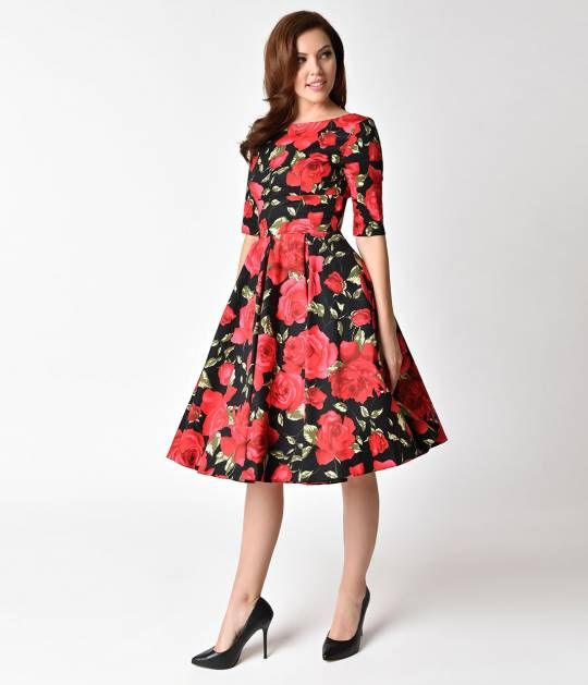 You'll have their hearts pumping, darling! This perfectly playful red and black Sorrento Floral Hepburn Dress from The Pretty Dress Company is a stunning Pin-up 1950s inspired piece! Featuring a vintage style, darted bodice with a sleeved silhouette frami