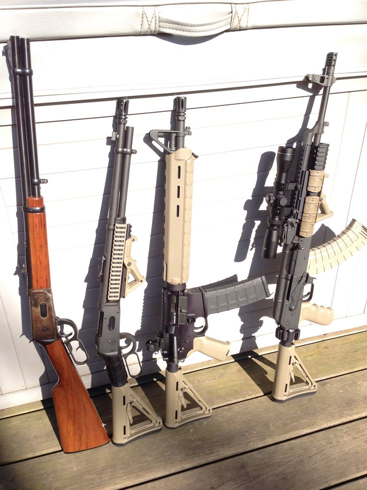 Mossberg 464spx shown next to a Winchester, AR-15 Dissipator,  and WASR AK all with FDE Magpul furniture.