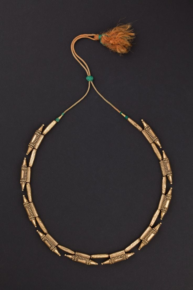 Kerala, India| Gold necklace made up of 10 amulet containers (Ta'vis) separated by embossed cylindrical beads.  ca.  1st half of the 20th century.