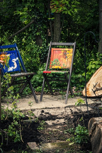 Old wooden folding chairs that I painted last year. Makes a great sitting spot in my garden!
