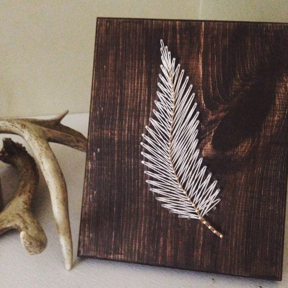 A simple feather that is beautifully handcrafted and strung. A 7x9 (approx.) string art feather board  Standard board is stained dark walnut, ivory & tan string.  Stain and string colors can be customized.