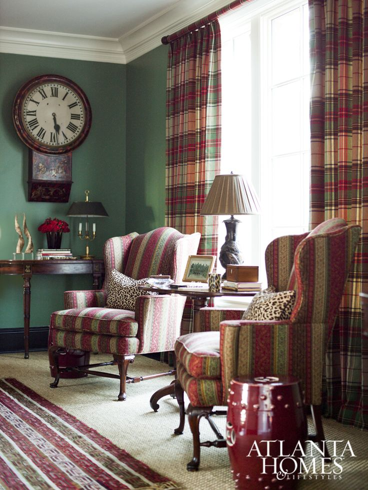 A handsome window, framed in an enveloping Ralph Lauren tartan, illuminates designer Judy Bentley's gallery, while the walls—painted Benjamin Moore's rich Fairmont Green—contribute to the cocooning effect.