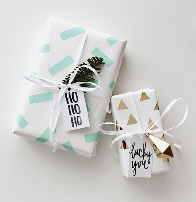 Add flair to your holiday gift wrapping with washi tape + ornaments.