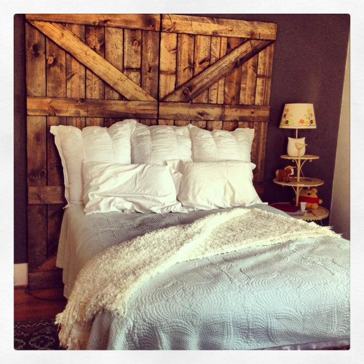 Just made our own barn door headboard! Love it ...