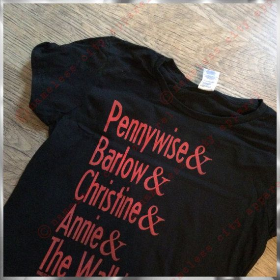 This is an awesome shirt inspired by an idea from our friend Jess. (follow her on IG @Jessicamap). Stephen King has created some of the most iconic Horror villains in the literary world, who can forget Pennywise the dancing clown from IT, Christine the killer Plymouth Fury, Mr.Barlow from Salems Lot, Annie Wilkes from Misery and of course Randall Flagg, The Walkin Dude!!! Now you can show your love for the bad guy with this incredible shirt. Hand Screen Printed on a premium cotton tee, like…