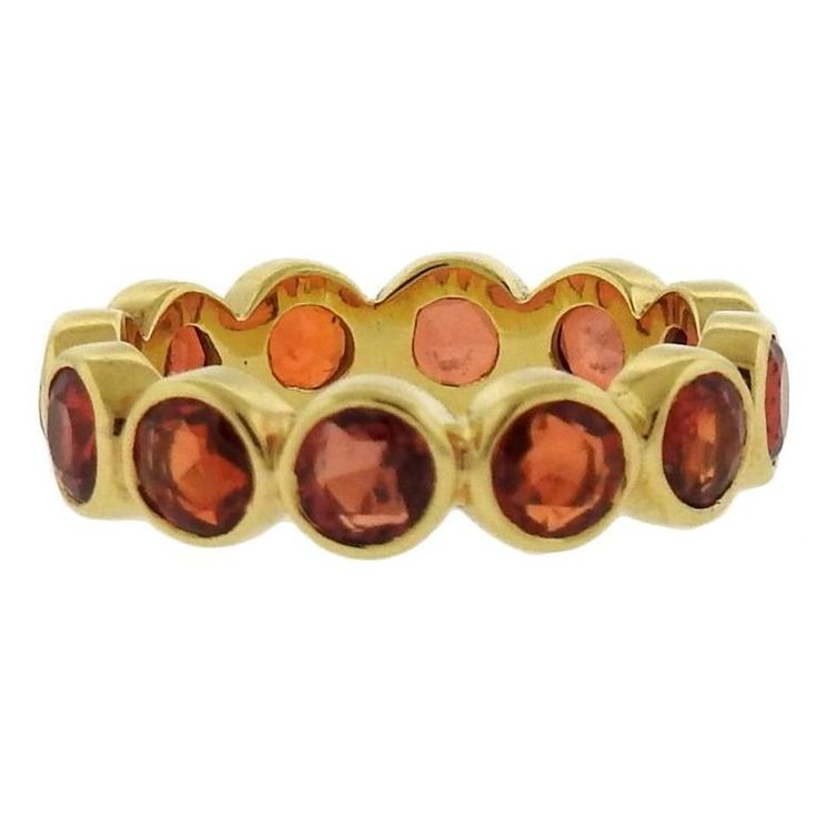 Temple St. Clair Red Sapphire Gold Eternity Band Ring   From a unique collection of vintage band rings at https://www.1stdibs.com/jewelry/rings/band-rings/
