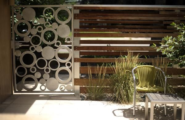 wood and metal fence, horizontal lines and circles for a modern feel