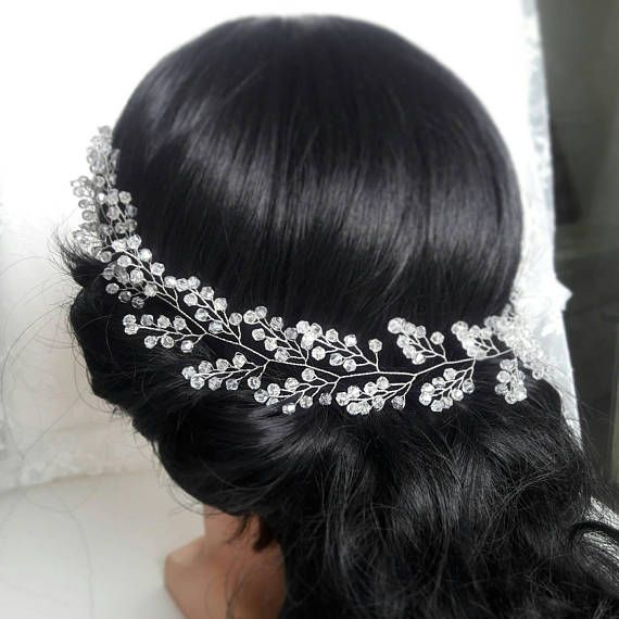 Check out this item in my Etsy shop https://www.etsy.com/listing/550852617/bridal-hair-vine-baby-breath-hair-piece