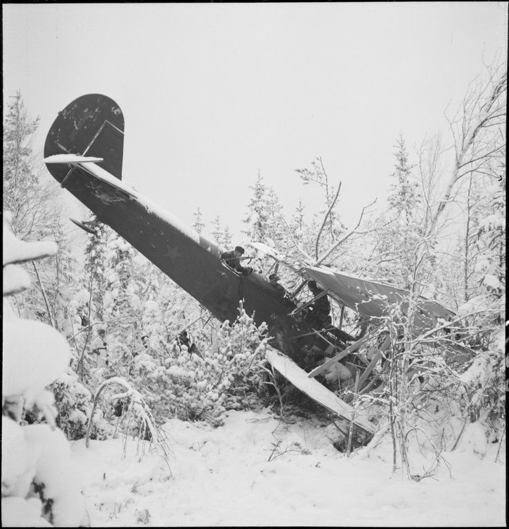 Finnish soldiers inspect a downed Soviet plane R-5.