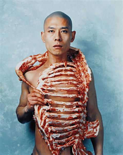 Zhang Huan, 1/2 (meat),1998 After thinking about the four elements individually I thought it was interresting to think about how every person is is made up of the same elements. This image made me think about preditors and so I thought that it was interresting in this topic since what a person eats is what they are made of.