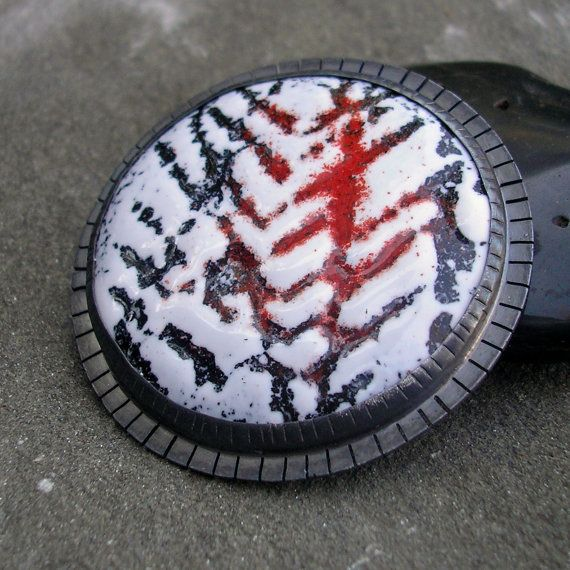 Enamel Brooch-- Blood on the Tracks, Handmade Sterling Silver This very striking brooch was inspired by the architectural lines of telephone wires, barb wire and the like. It is stark black, white, and red enamel on copper set in a handmade sterling silver setting. After I made it, I