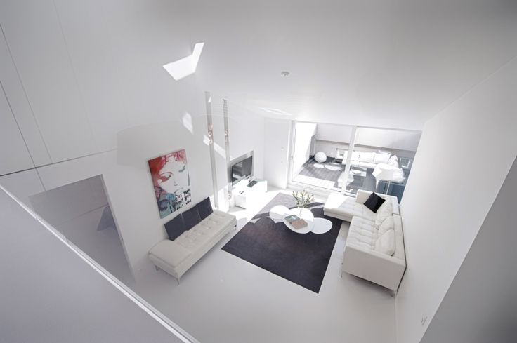 The penthouse with two bedrooms. View to the living area.