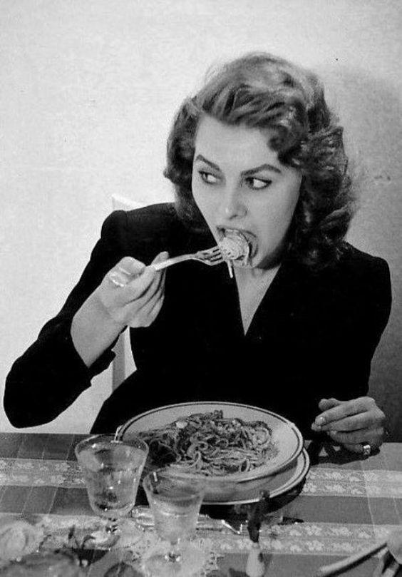 Sophia Loren eating spaghetti in a restaurant in Italy, 1953.