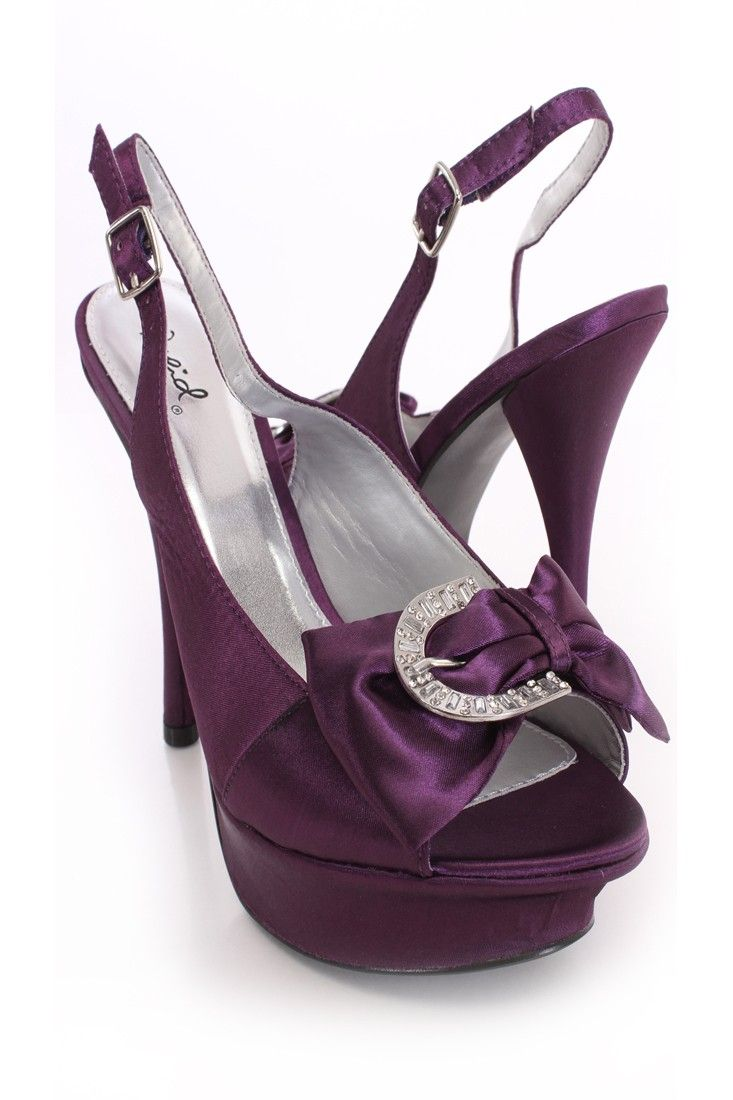 The features for these heels include a faux satin upper with slingback  buckle strap closures,