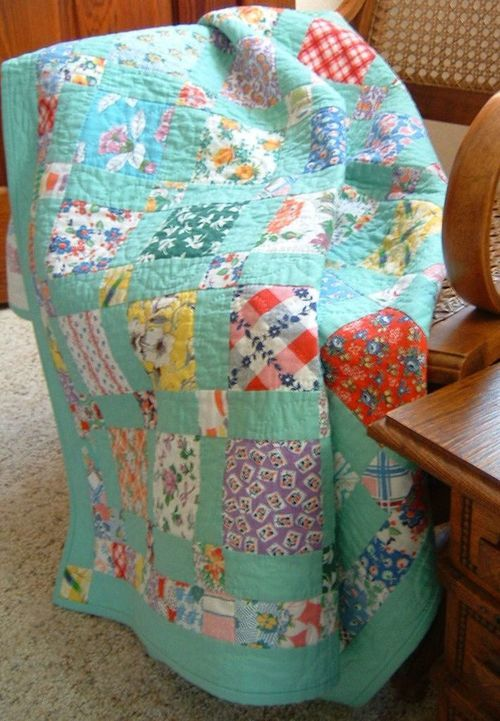 """Lovely pastels, traditional patchwork quilt. It exudes a """"snuggle"""" quality. 1930's Reproduction Feedsack prints"""