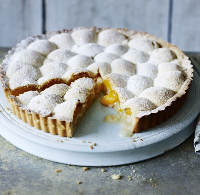 The pastry and marzipan melt over the apricot halves to make a wobbly top for this sweet, and simply delicious, fruit tart