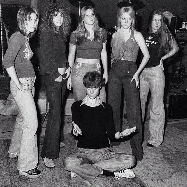 "naturalbornworldshakers:  1975, The Runaways - Joan Jett, Peggy Foster, Sandy West, Cherie Currie, and Lita Ford with band manager Kim Fowley - a pretty crass dude who once had sex in front of The Runaways (his idea of Sex Ed) to, ""…teach you dogs how to f___."" Ego-tripping sicko, man. See more at selvedgeyard.com today."