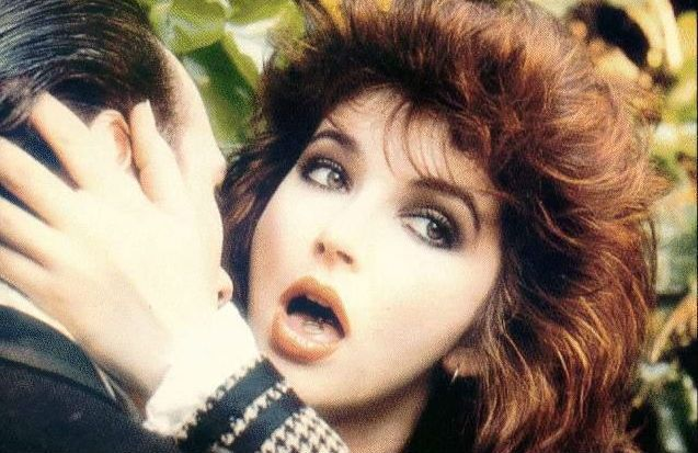 From the Dangerous Minds archive…  Like many Americans, my first exposure to Kate Bush was via her fourth album, 1982's The Dreaming, for despite being a chart-topper the world over, and with a 1978 appearance on SNL under her belt, Bush had virtually zero profile in America before it. The Dreaming is also my favorite Kate Bush album, although it doesn't have a single one of my favorite Kate Bush songs on it.   Even during a period of popular music that produced such off-kilter masterpiec...