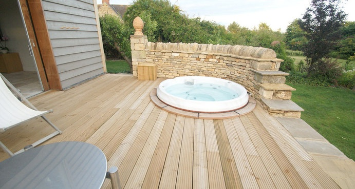 Our J200 hot tub nestled perfectly into a decked surface - stunning don't you think?