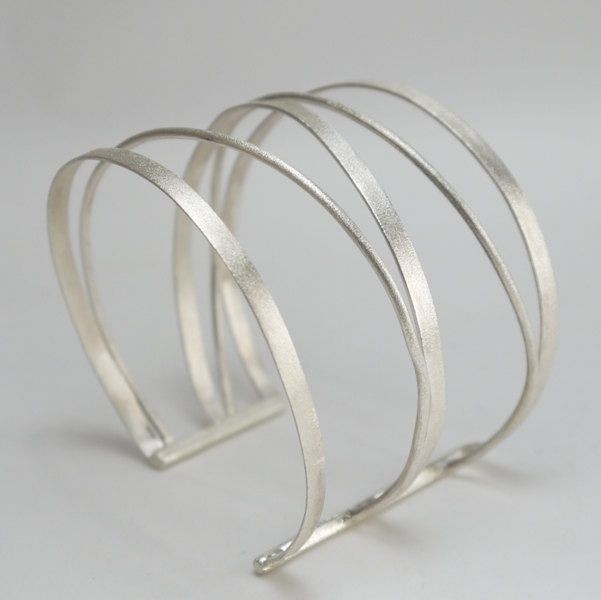 Statement silver cuff. Made of silver wires inspired of ancient Rome and Greek bracelets in a new modern design. via Etsy.