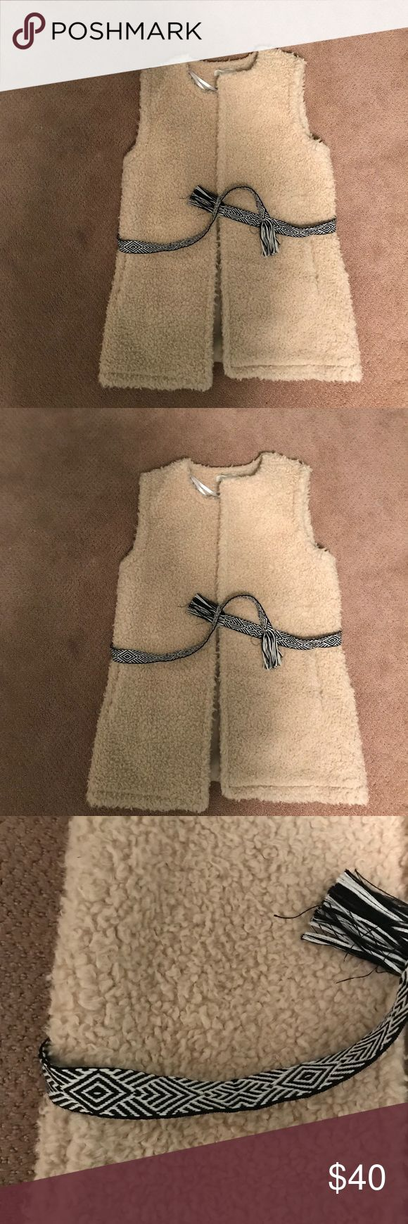Cream vest with removable belt This vest is so warm and so flattering. Looks cute with or without the belt H&M Jackets & Coats Vests