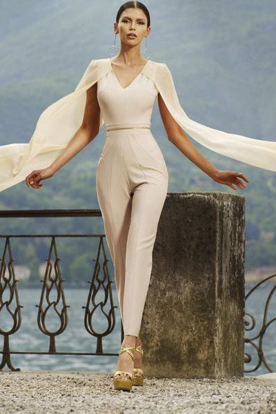 A jumpsuit is a glamorous alternative to a dress for your next occasion. Our Natasha jumpsuit, created in a stunning nude color, has chiffon cape sleeves and an eye-catching gold zip detail. Fit Advic