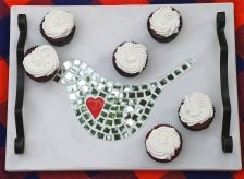 Wooden tray with red heart inlay embedded in a trendy mosaic bird design.