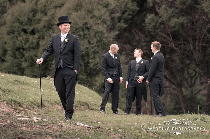 Groom and groomsmen having a laugh together. Check out other wedding photography by Anthony Turnham at www.snapweddingphotography.co.nz