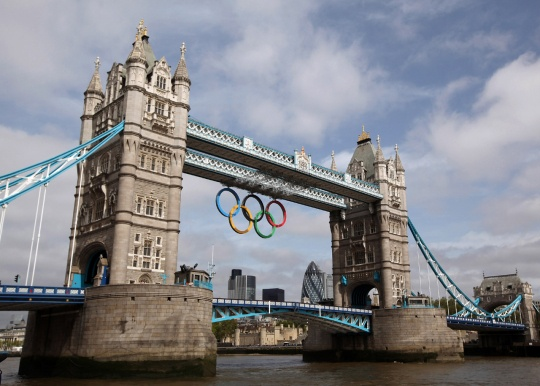A giant set of Olympic rings are displayed from Tower Bridge on June 27, 2012, in London. The massive rings - 82 feet wide and 37 feet tall - were unveiled to mark one month to go until the start of the 2012 Olympic Games on July 27, 2012.: London2012, 2012 Olympics, London 2012, Olympics Games, Favorite Places, Olympics Rings, London Olympics, Random Thoughts, Towers Bridges