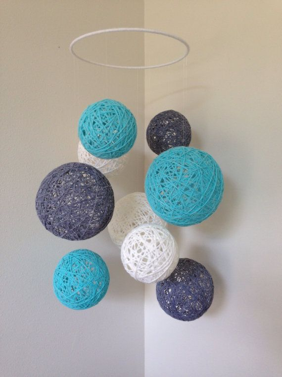 Mobile with White Gray and Aqua yarn balls by Backporchcrafts85
