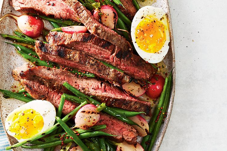 French Bistro Steak Salad—Flank steaks are large, thin cuts of beef that cook within minutes on the grill. Paired with grilled beans and radishes, and elevated with a punchy Dijon dressing, this is an easy dinner worthy of any Paris bistro.