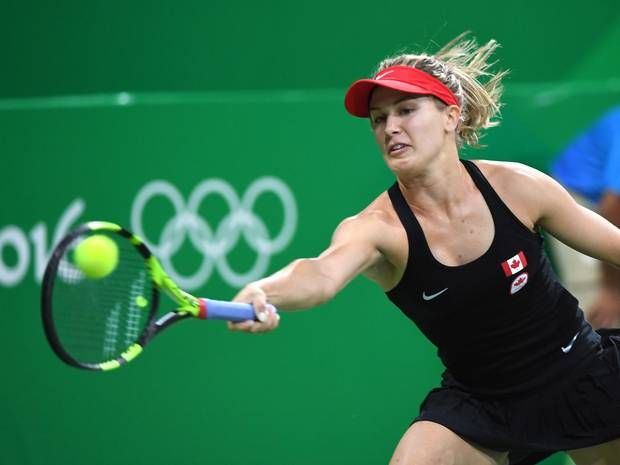 Canada's Eugenie Bouchard returns to Sloane Stephens, of the United States, in first round women's singles tennis at the 2016 Olympic Games in Rio de Janeiro, Brazil on AugUST 6, 2016.