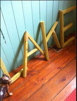 We made these letters from strips of barn board. Painted then distressed.
