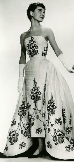 cool Audrey Hepburn, love her gown and gloves....