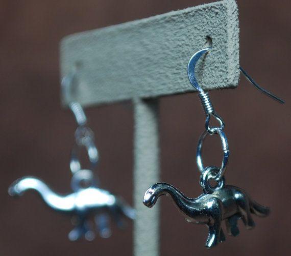 Brontosaurus earrings by AbandonedWarehouse on Etsy