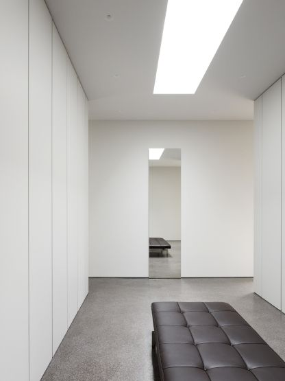 Walk-in closet inside the House in Deurle by David Chipperfield.