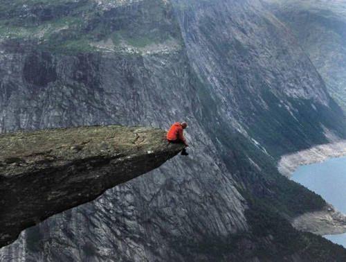 This shot is taken on a Norway's cliff Prekestolen (also known as Preacher's Pulpit).