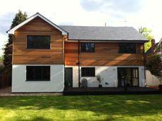 Cedar clad second floor, slate roof, white render Steele-Perkins - Self Build