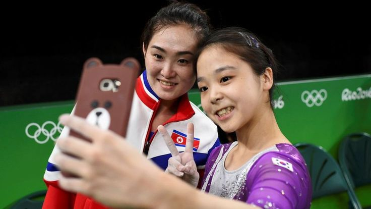 North and South Korea gymnasts at the Rio 2016 Olympic Games show the world a moment of unity, in the form of a selfie.
