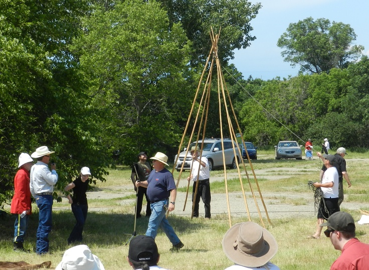 Setting up a teepee on the set of the 2012 Burning Sun Production of The Medicine Line.  http://www.inkwellinspirations.com/2012/08/the-medicine-line-outdoor-show.html