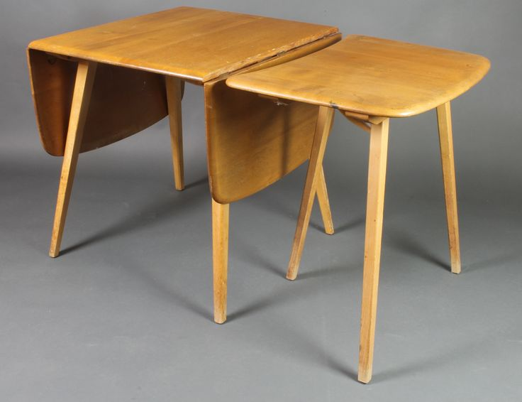 "Lot 940, An Ercol light elm drop flap dining table 28""h x 49"" x 24"" when closed by 54 1/2"" when extended, together with a 3 legged D shaped extension 28""h x 18"" x 27 1/2"" sold for £240"