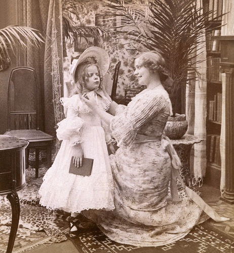 1902 -- Victorian mother dressing daughter