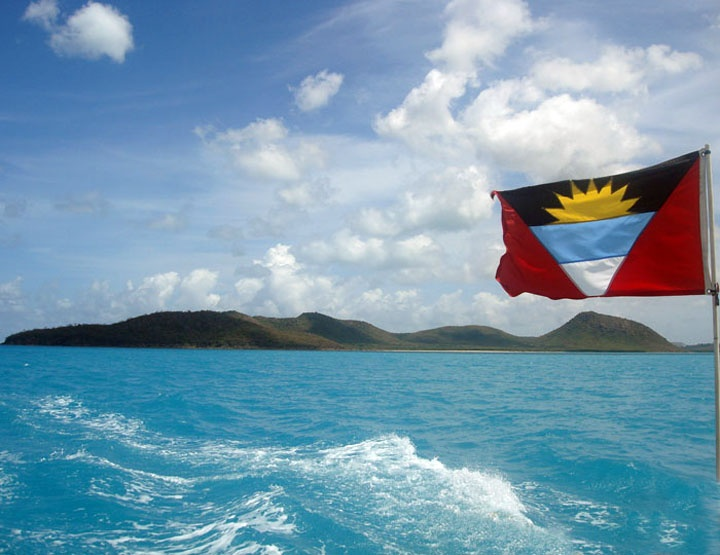 Antigua flag with its crystal light blue water
