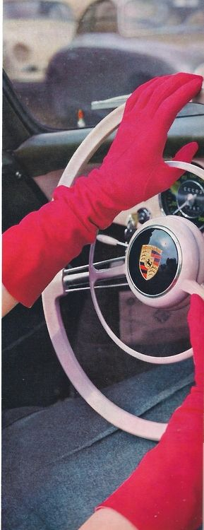 RED GLOVES AT THE STEERING WHEEL? The photographer of this shot admitted it might be hard to drive this way in the long run. However, a woman's hand on the wheel always makes a nice subject for shooting. liebe zu ihm, 1960